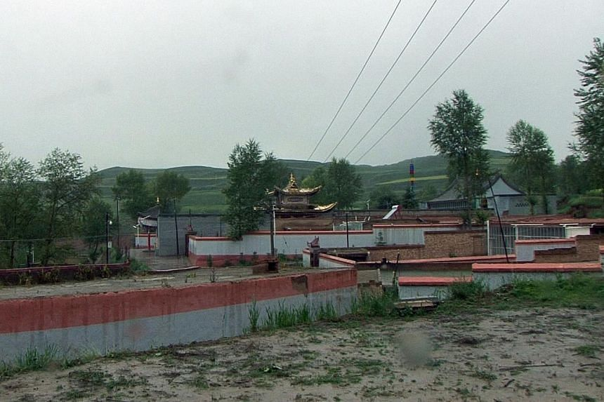 This screen grab image taken from AFP video on July 26, 2013 shows an external view of the Dalai Lama's family home in Hongai (Taktser) village in Pingan county, in north-west China's Qinghai Province. The Chinese town where the Dalai Lama was born i