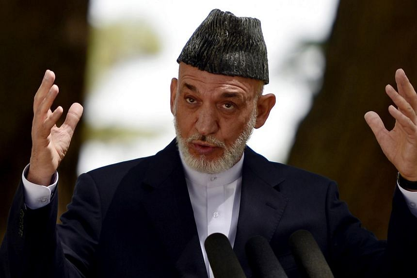 Afghan president Hamid Karzai addresses a press conference at the presidential palace in Kabul on Aug 24, 2013. Afghan President Hamid Karzai is to hold key talks with Pakistan's newly elected government on Monday, searching for direct communication