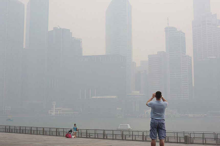 The Singapore city skyline obscured by the haze on June 20, 2013. Singapore may have to prepare for hazier skies over the next few days, after the number of hot spots in Sumatra rose nearly six-fold from 86 on Saturday to 488 on Monday. -- MY FILE PH