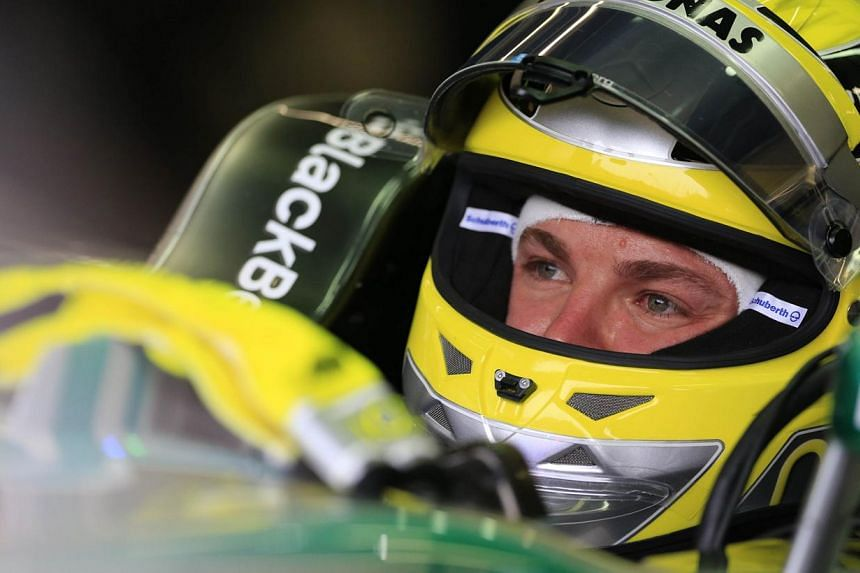 Mercedes' German driver Nico Rosberg sits in the pits during the third practice session at the Spa-Francorchamps circuit in Spa on August 24, 2013 ahead of the Belgium Formula One Grand Prix. Nico Rosberg admitted he and Mercedes had been surpri