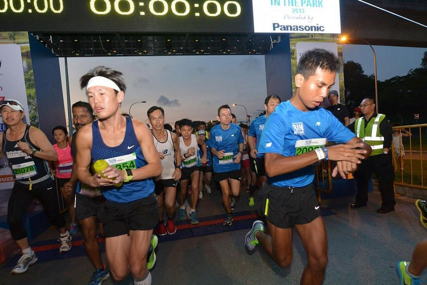 Runners in the 15km category at the start line of the ST Run in the Park 2013. -- ST PHOTO: ALPHONSUS CHERN