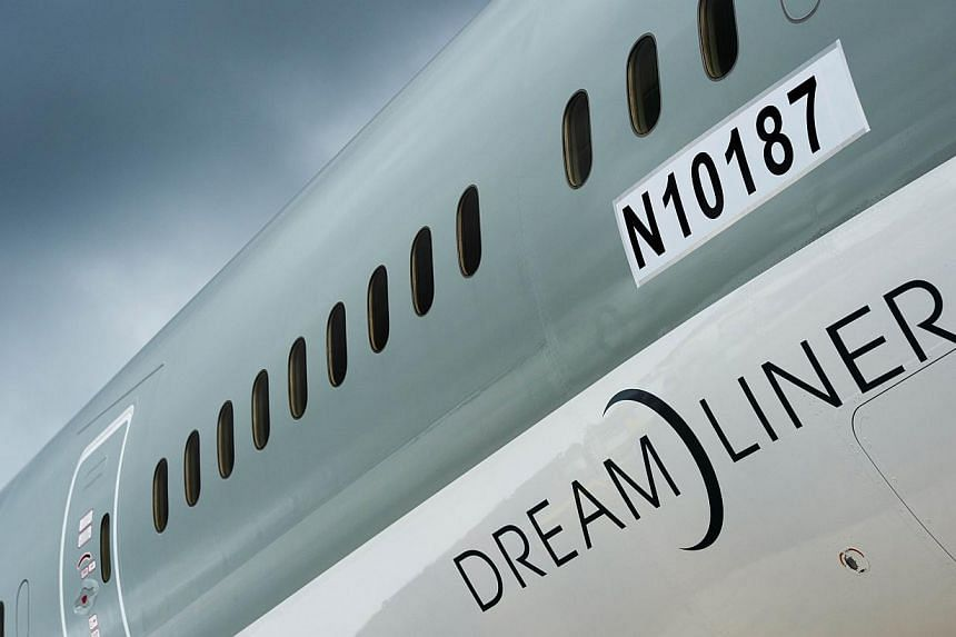 A picture dated July 9, 2012 shows a Boeing 787 Dreamliner aircraft at the Farnborough International Airshow in Hampshire, southern England. China's Xiamen Airlines has finalised an order for six Boeing 787 Dreamliners to expand its long-haul interna