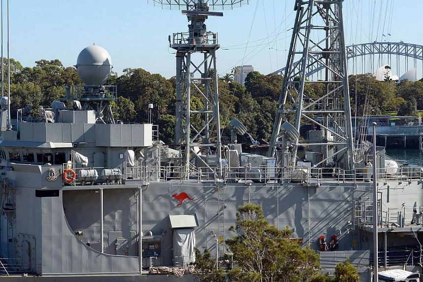 This photo taken on May 3, 2013, shows the Royal Australian Navy's Adelaide class guided-missile frigate, the HMAS Melbourne, at the Garden Island Naval Dockyard near Sydney. Australian Prime Minister Kevin Rudd on Tuesday said key naval assets could