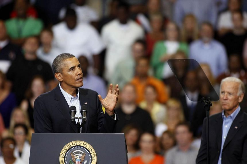 U.S. President Barack Obama, (L) speaks at an event as U.S. Vice President Joe Biden, (R), looks on at Lackawanna College on August 23, 2013 in Scranton, Pennsylvania. Obama is on his second day of a bus tour of New York and Pennsylvania to discuss h