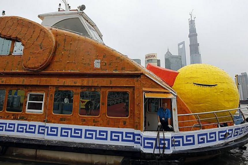 """Shanghai's """"roasted"""" version of Dutch artistFlorentijn Hofman's giant yellow duck, complete with drumsticks and crispy brown skin, floatson the Huangpu River in Shanghai onMonday, Aug 26, 2013.Not to be outdone by Hong Kong, w"""