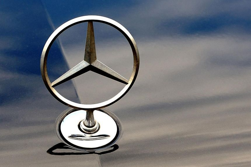 The logo of Mercedes Benz car of German auto giant Daimler is pictured on Tuesday, Aug 27, 2013, in Bailleul. France's top administrative court on Tuesday overruled a contentious government decision to ban the sale of some Mercedes models on the grou