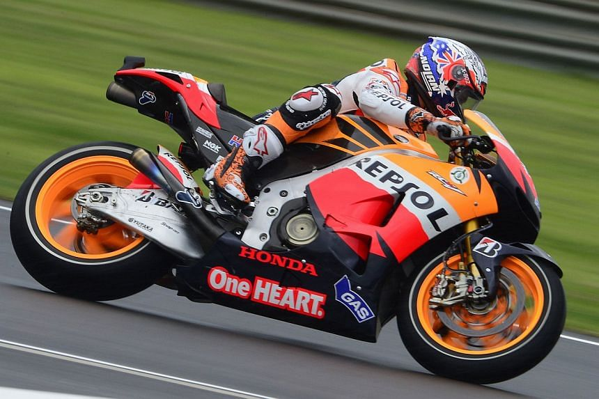 Honda team boss Livio Suppo on Tuesday ruled out Casey Stoner (above) making a wildcard appearance at his home Australian Grand Prix despite the former world Moto GP champion testing with the Japanese manufacturer. -- FILE PHOTO: AFP