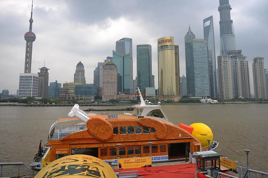 """Shanghai's """"roasted"""" version of Dutch artistFlorentijn Hofman's giant yellow duck, complete with drumsticks and crispy brown skin, floatson the Huangpu River in Shanghai onTuesday, Aug 27, 2013.Not to be outdone by Hong Kong,"""