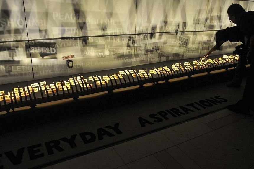 """Everyday Aspirations (above), a 14m-long installation by artist Karen Mitchell, on display at an exhibition last year. The artwork is made up of 365 pieces of """"words of aspirations"""" (below), but 114 pieces have gone missing after the opening of this"""