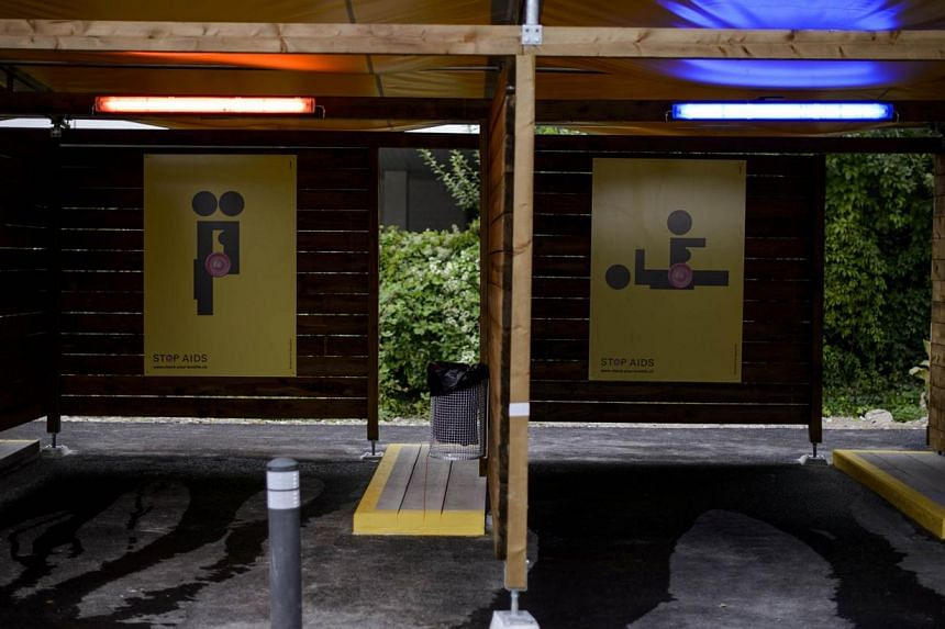 """Two empty so-called """"sex boxes"""" are seen at the opening day of Switzerland's first sex drive-in on Aug 26, 2013, in Zurich, which is aiming to get prostitution off the city streets.The sex drive-in opened for business on Monday to a big fanfare"""