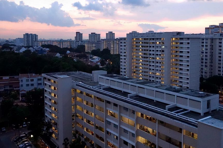 Bedok South HDB estate at dusk on June 2, 2013. Newly-minted Singapore permanent residents will now have to wait three years before buying a resale public flat, instead of straightaway after they become PRs.-- ST FILE PHOTO: JAMIE KOH