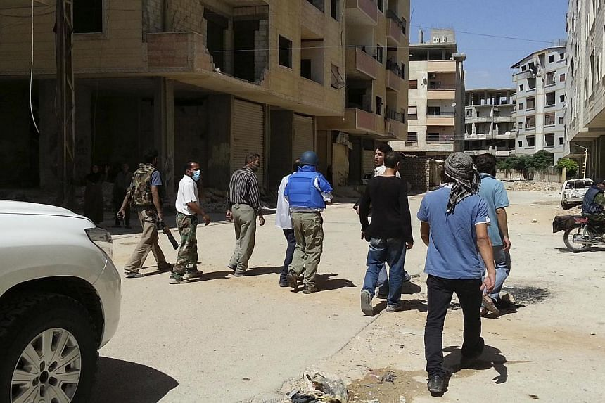 UN chemical weapons experts inspect one of the sites of an alleged poison gas attack in the southwestern Damascus suburb of Mouadamiya on Aug 26, 2013. North Korea tried to export gas masks to Syria but they were seized in Turkey along with arms and