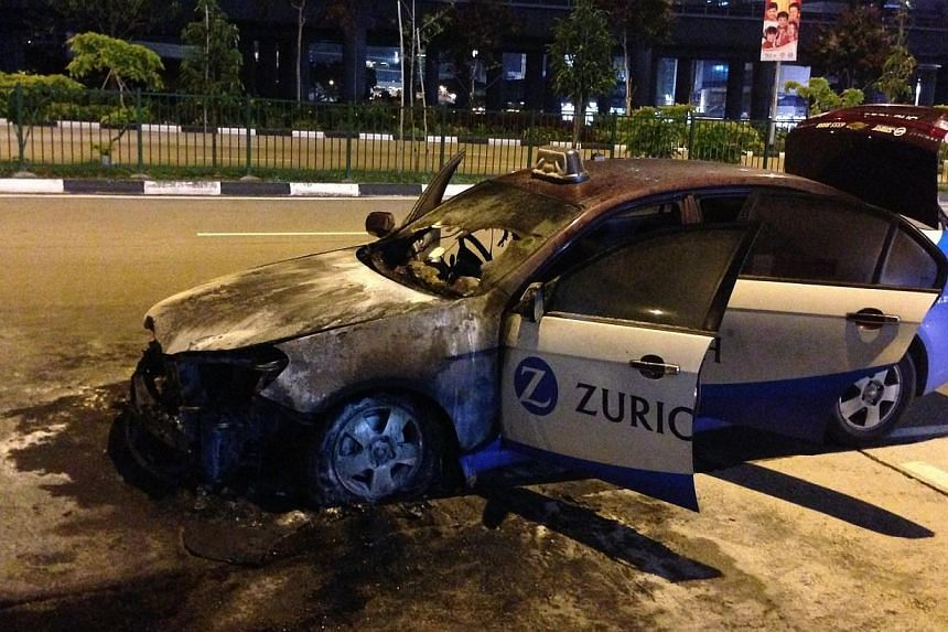 An SMRT taxi caught fire on Tuesday evening in front of Block 131 Jurong Gateway Road.The Singapore Civil Defence Force received a call at 7.59pm and dispatched one fire engine, one Red Rhino, and two fire bikes.Upon arrival, the taxi's e