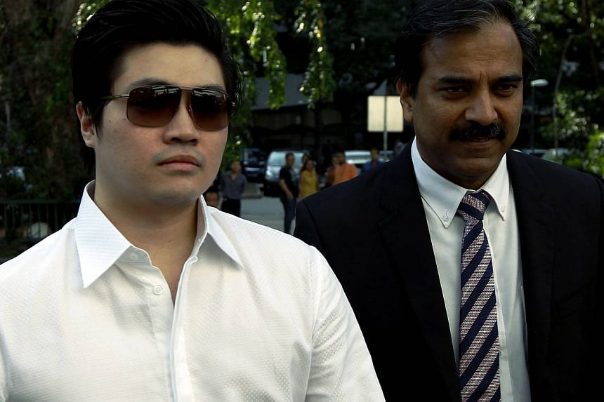 Eric Ding Si Yang (left) and his Lawyer Hamidul Haq arrive at the court on Aug 27, 2013. The match-fixing trial of Ding resumed on Tuesday with a twist - two key prosecution witnesses are now not showing up. -- ST PHOTO: WONG KWAI CHOW