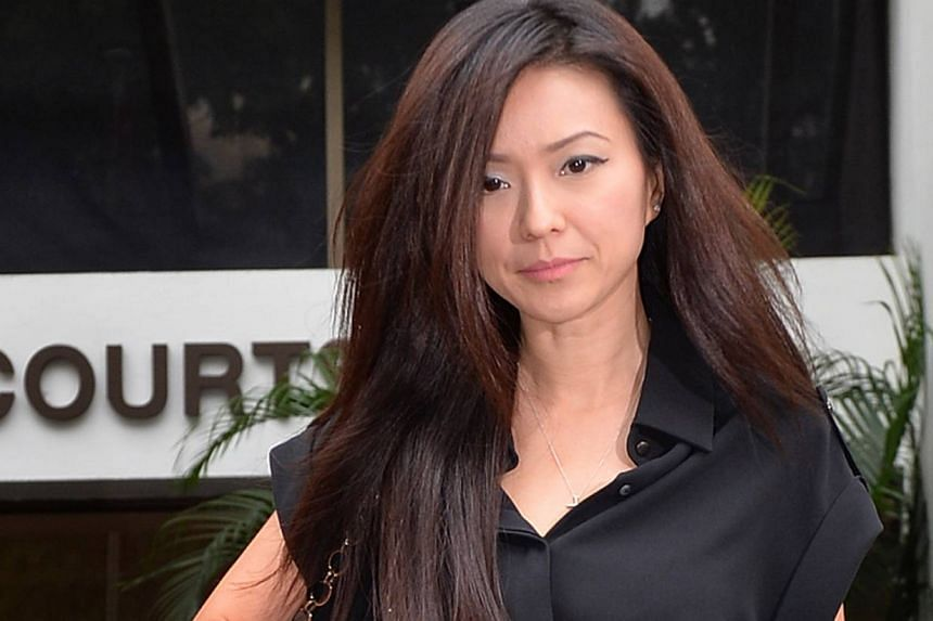 Serina Wee, a leader of City Harvest Church, leaves the court during lunch break on Aug 26, 2013. Wee was handling music firm Xtron Productions' accounts and finances even when she was an employee of City Harvest Church, the state sought to show on T