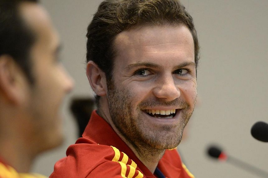 Spain's forward Juan Mata (R) smiles during a press conference at the team's hotel in Rio de Janeiro on June 18, 2013.Arsenal manager Arsene Wenger has expressed admiration for Juan Mata, but he was reluctant to reveal the extent of the club's