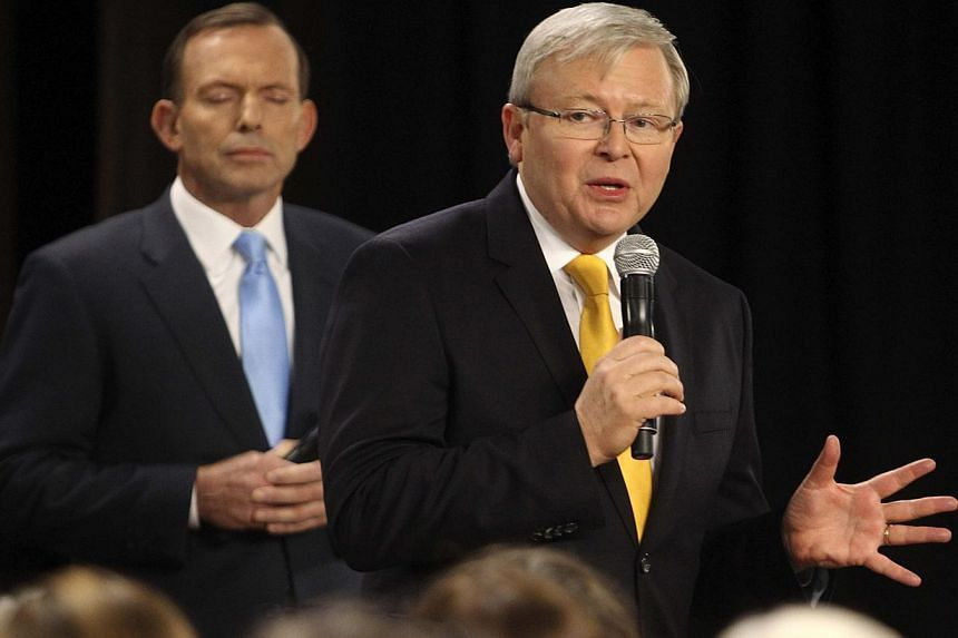 Australian Prime Minister and leader of the Australian Labor Party Kevin Rudd (right) speaks as the leader of the conservative opposition Tony Abbott listens on during their People's Forum in Brisbane on Aug 21, 2013. Mr Rudd on Wednesday attacked el