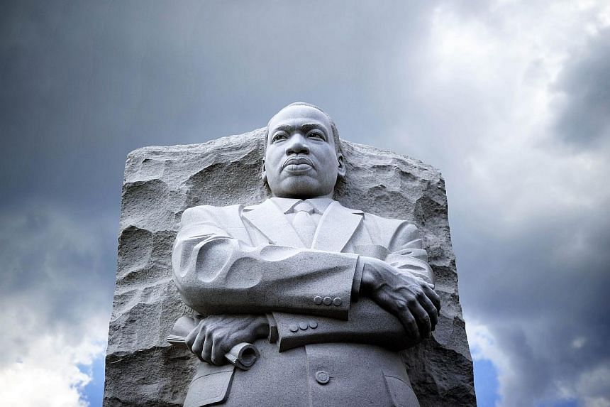 """The statue of Martin Luther King Jr. is pictured at a memorial on Aug 24, 2103, in Washington, DC, as thousands of people gather to commemorate the 50th anniversary of The March on Washington. Fifty years after the """"dream"""" of racial equality invoked"""