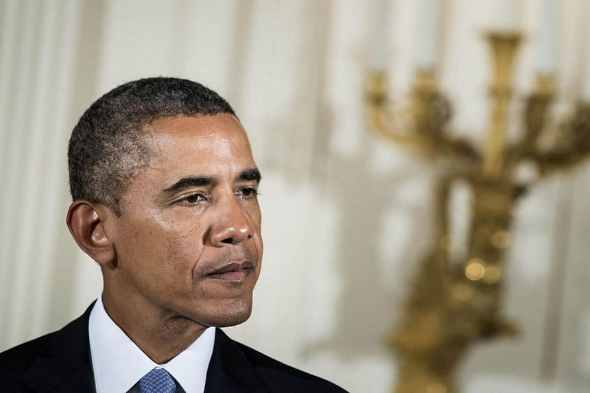 United States President Barack Obama speaks during a ceremony in the East Room of the White House on Aug 26, 2013 in Washington, DC. Mr Obama called British Prime Minister David Cameron about Syria again on Tuesday, the White House said, part of a fl