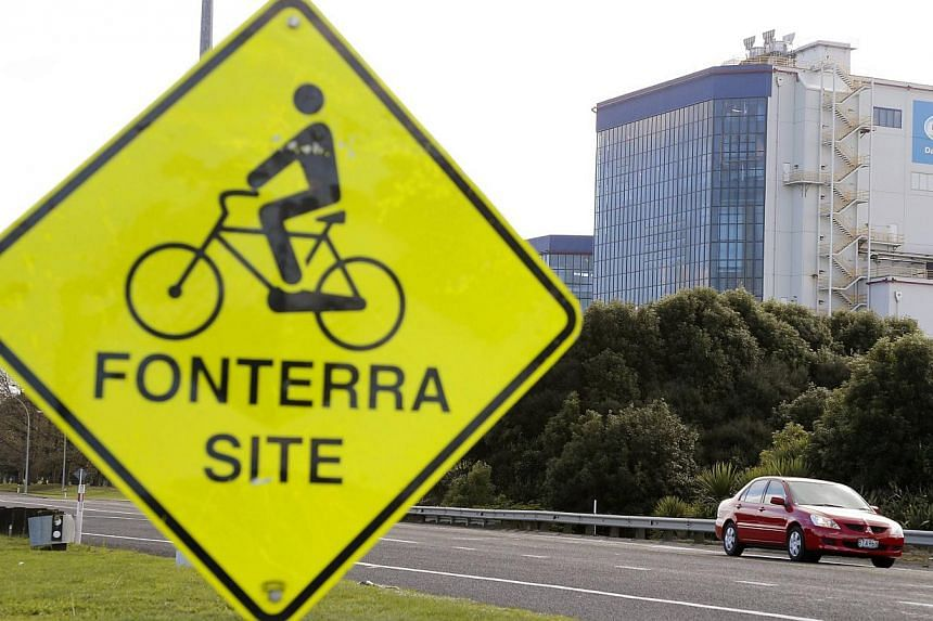 The Fonterra Te Rapa plant is seen behind a sign for cyclists near Hamilton in this Aug 6, 2013 file photo. Dairy giant Fonterra's products at the centre of a global contamination scare earlier this month did not contain a bacteria that could cause b