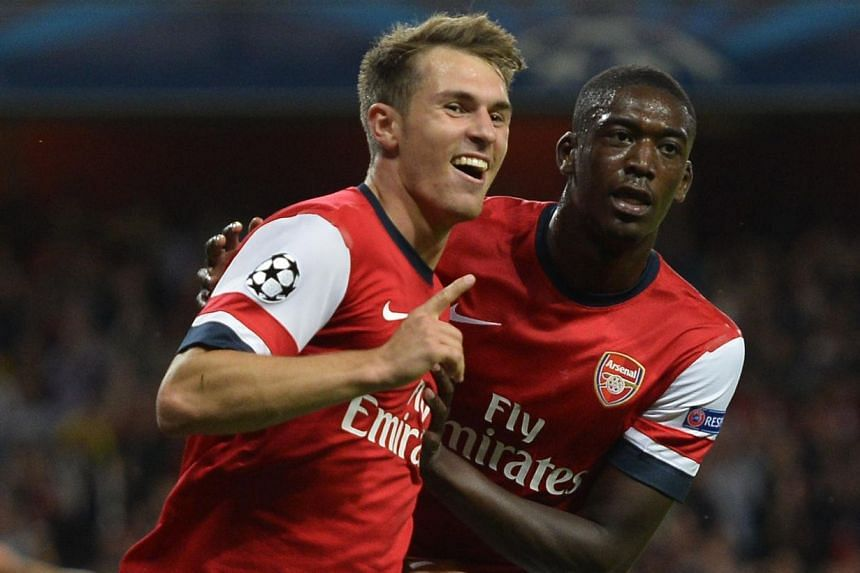 Arsenal's Aaron Ramsey (L) celebrates his goal against Fenerbahce with teammate Yaya Sanogo during their Champions League soccer match at the Emirates Stadium in London August 27, 2013.A brace from Aaron Ramsey earned Arsenal a 2-0 win over Fen