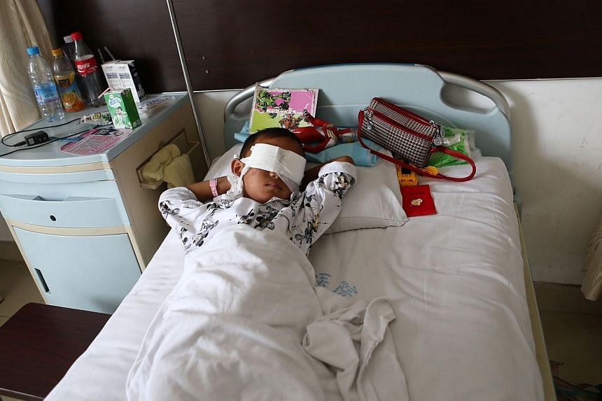 A boy lies on his hospital bed with his eyes covered with bandages in a hospital in Taiyuan, Shanxi province on Tuesday, Aug 27, 2013.A six-year-old Chinese boy who had his eyes gouged out does not know he has been blinded and asks his family w