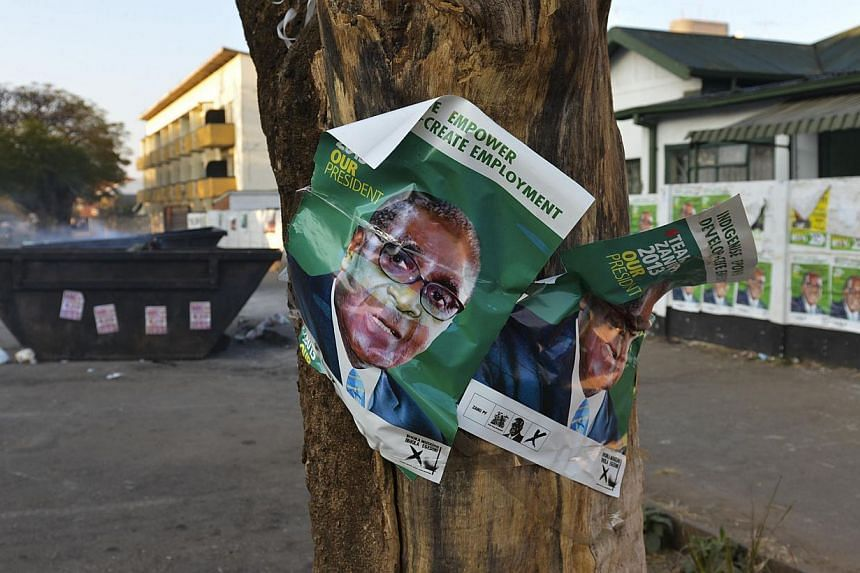 Election campaign posters in support of Zimbabwean president Robert Mugabe in Zimbabwe on Tuesday, July 30, 2013. A Zimbabwean man has been charged for allegedly using President Robert Mugabe's election campaign poster as toilet paper, loca