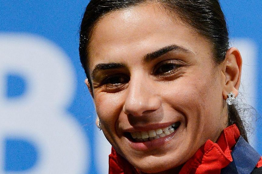 Nevin Yanit smiles after winning the final of the women's 60m Hurdles at the European Indoor athletics Championships in Gothenburg, Sweden on March 1, 2013. The Double European 100m hurdles champion has been handed a two-year suspension for dru