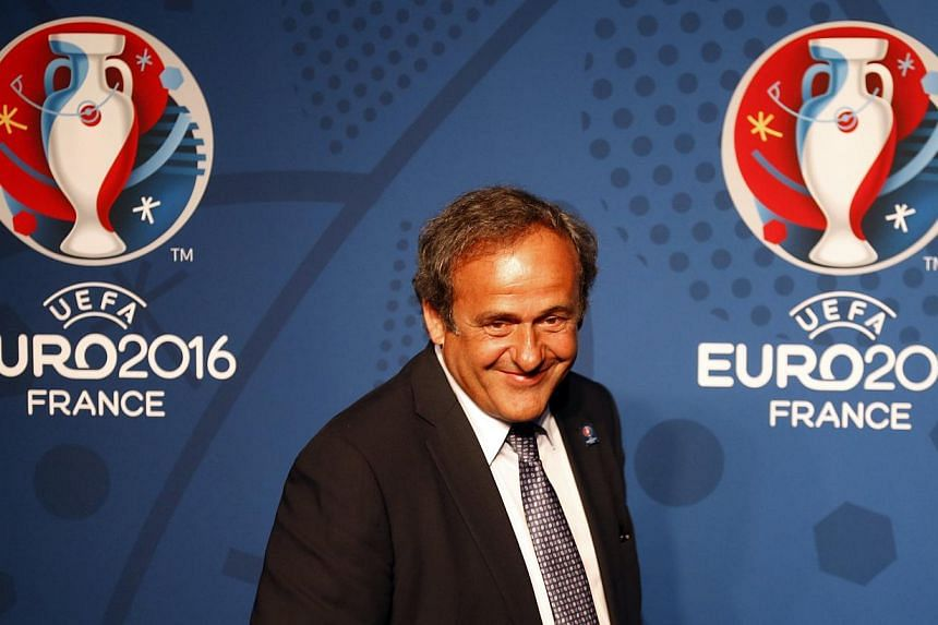 Uefa president Michel Platini walks in front of the Uefa Euro 2016 logo at a news conference in Paris on June 26, 2013. Mr Platini says he remains unsure whether he will run for the same post at the head of world governing body Fifa when cu