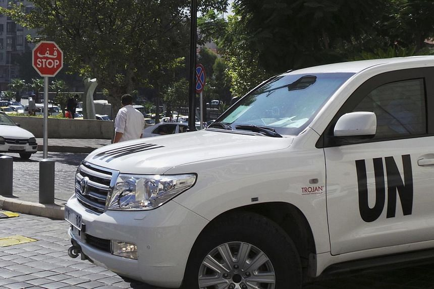 A UN vehicle carrying a team of United Nations chemical weapons experts, leaves the hotel where they are staying in Damascus on Wednesday, Aug 28, 2013. UN inspectors on Wednesday inspected a second site on the outskirts of the Syrian capital suspect