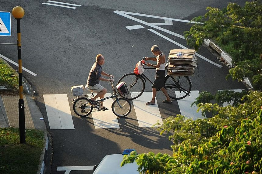 Cyclists crossing a zebra crossing at the junction of Upper Serangoon Road and Hougang Avenue 5. The number of accident claims involving cyclists received by insurance firm AIG has doubled in the three years from 2010 to last year. -- ST FILE PHOTO: