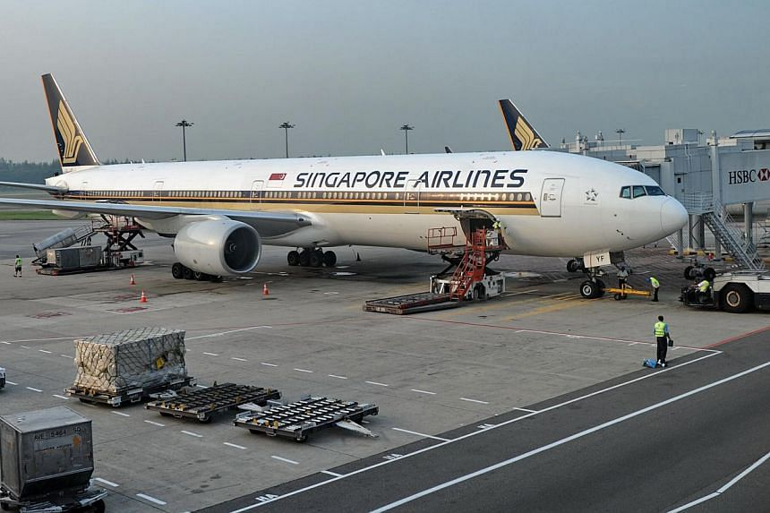 In the latest controversy involving Chinese tourists, a group of mainland travellers surprised SIA staff when they refusing to hand over 30 sets of stainless steel tableware during a recent flight, Chinese media reported. -- FILE PHOTO: AFP