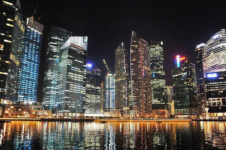 The Singapore Central Business District (CBD) skyline by night on Sept 22, 2011. More people made it to the millionaires club last year, with 4,220 taxpayers having assessable income of more than $1 million each. -- ST FILE PHOTO: ALPHONSUS CHERN