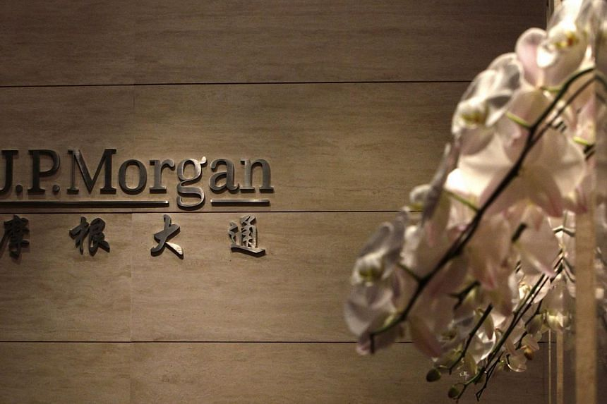 The JPMorgan sign is pictured at its Beijing office, in this picture taken on Dec 13, 2010. US government investigations into the hiring practices of JPMorgan in China have uncovered evidence including a spreadsheet that links hires to specific deals
