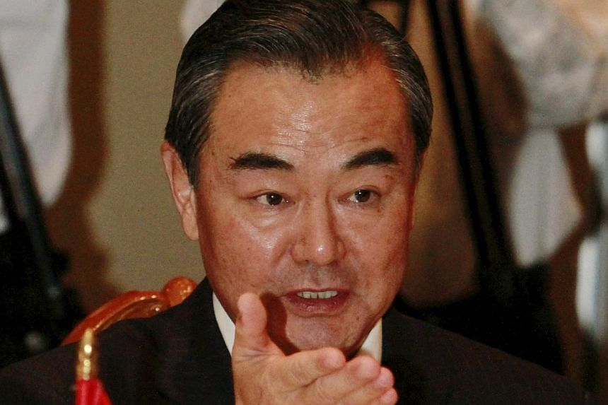 Chinese Foreign Minister Wang Yi gestures during a meeting with Cambodian Foreign Minister Hor Namhong, unseen, in Phnom Penh, Cambodia, on Wednesday, Aug 21, 2013. Mr Wang urged restraint in the growing tensions over Syria, saying any military inter