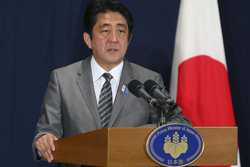 Japan's Prime Minister Shinzo Abe speaks during a news conference in Doha on Aug 28, 2013. Japanese Prime Minister Shinzo Abe has promised to the world his government will play a greater role in stopping leaks of highly radioactive water at Fukushima