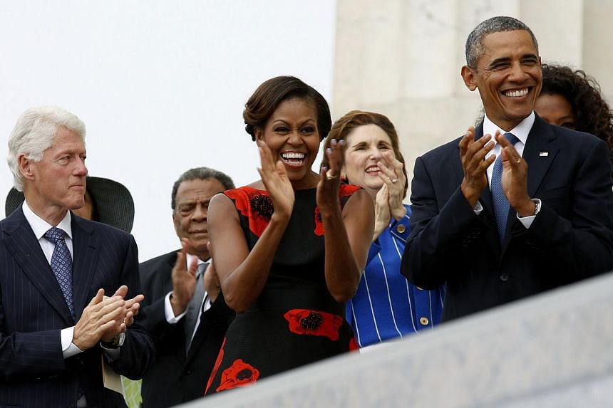 """Former US president Bill Clinton, first lady Michelle Obama and US President Obama attend the commemoration of the 50th anniversary of the March on Washington and Martin Luther King Jr's """"I have a dream"""" speech at the Lincoln Memorial in Washington o"""
