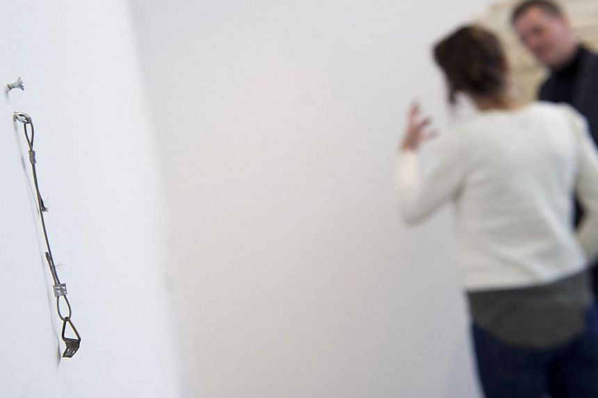 A picture taken on March 22, 2013 shows an empty wall in the Van Bommel Van Dam museum in Venlo, south-eastern Netherlands. A cunningly disguised stolen work by Dutch contemporary artist Jan Schoonhoven managed to fool experts at the world's largest