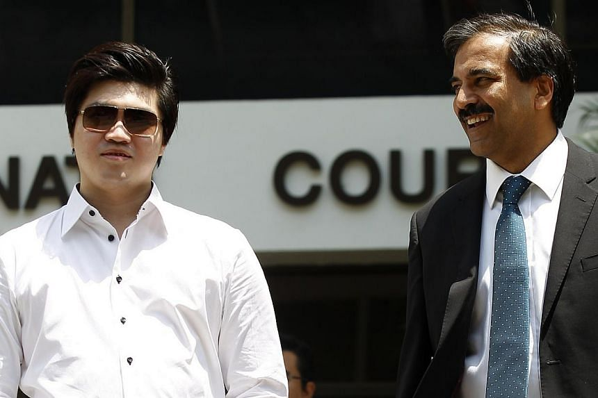 Eric Ding Si Yang (left) and his Lawyer Hamidul Haq (right) leaving the court on Aug 29, 2013. District Judge Toh Yung Cheong is expected to deliver his verdict whether four statements made by two deported Lebanese linesmen can be admitted as court e