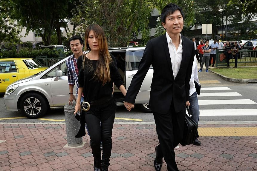 Pastor Kong Hee (right), founder of City Harvest Church with his wife Ms Ho Yeow Sun, also known as Sun Ho outside Subordinate Courts. City Harvest Church members had overwhelmingly supported its co-founder Ho Yeow Sun's music career as a way to