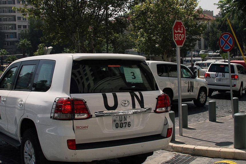 A convoy of United Nations (UN) vehicles leave a hotel in Damascus on Monday, Aug 26, 2013, carrying UN inspectors as they travel to the site of a suspected deadly chemical weapon attack the previous week in Ghouta, east of the capital. A UN tea