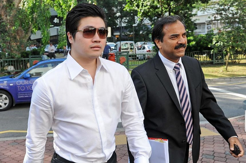 Singaporean businessman Eric Ding Si Yang (left) arrives at a district court with his lawyer in Singapore on Tuesday, Aug 27, 2013.Four statements given by two deported Lebanese linesmen will be admitted as court evidence in the corruption tria