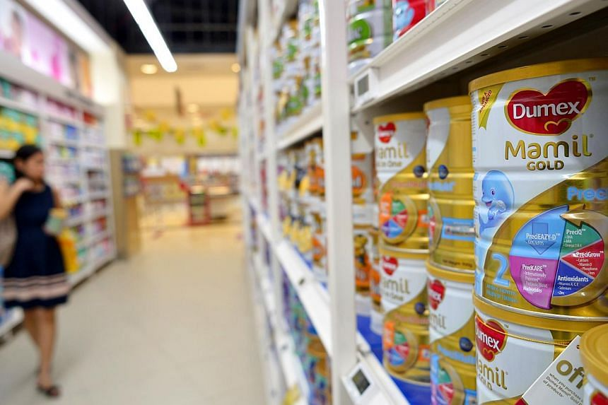 Mamil Gold 2 milk powder on the shelves of a supermarket on Aug 5, 2013.Infant formula producer Danone Dumex has gotten the all-clear once again, after a contamination scare caused them to recall several tins earlier this month as a precaution.