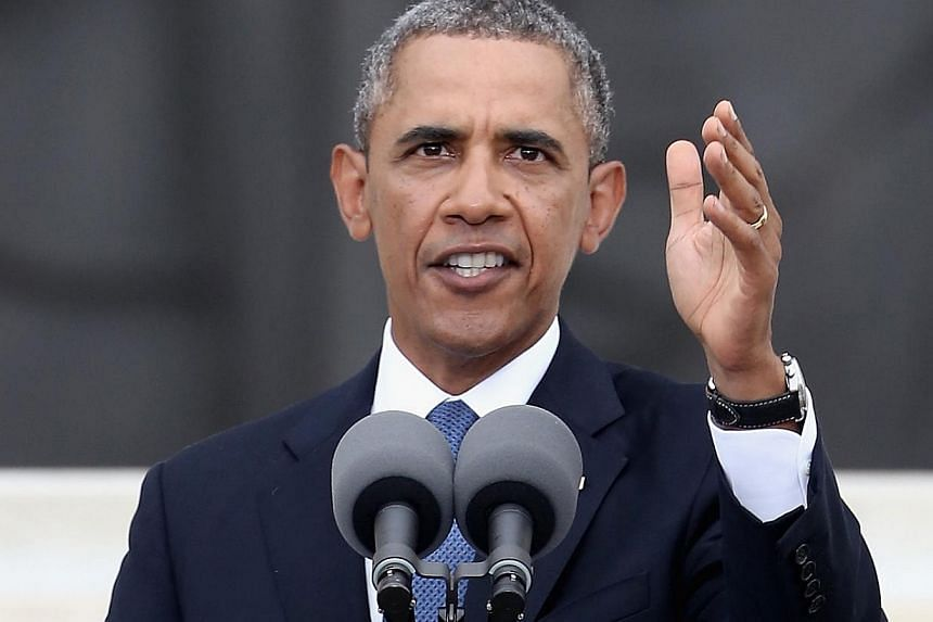 """US President Barack Obama speaks during the Let Freedom Ring ceremony on the steps of the Lincoln Memorial on Aug 28, 2013 in Washington, DC. The event was to commemorate the 50th anniversary of Dr Martin Luther King Jr.'s """"I Have a Dream"""" speech and"""