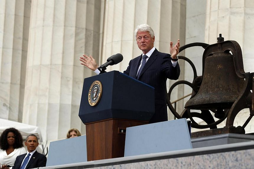 """Former US President Bill Clinton speaks from the steps of the Lincoln Memorial during the commemoration of the 50th anniversary of the March on Washington and Martin Luther King Jr's """"I have a dream"""" speech in Washington on Aug 28, 2013. -- PHOTO: RE"""