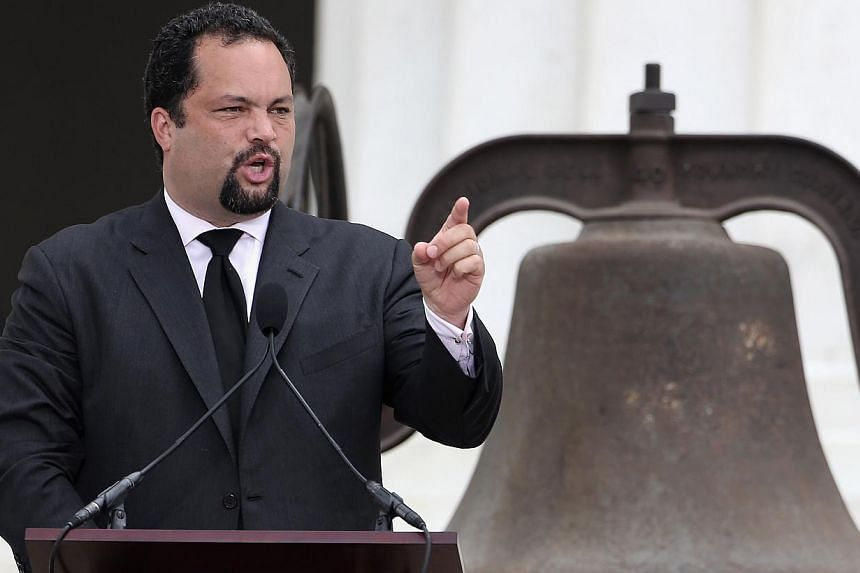 "President and CEO of the NAACP Benjamin Todd Jealous speaks during the Let Freedom Ring ceremony at the Lincoln Memorial on Aug 28, 2013 in Washington, DC. The event was to commemorate the 50th anniversary of Dr Martin Luther King Jr.'s ""I Have a Dre"
