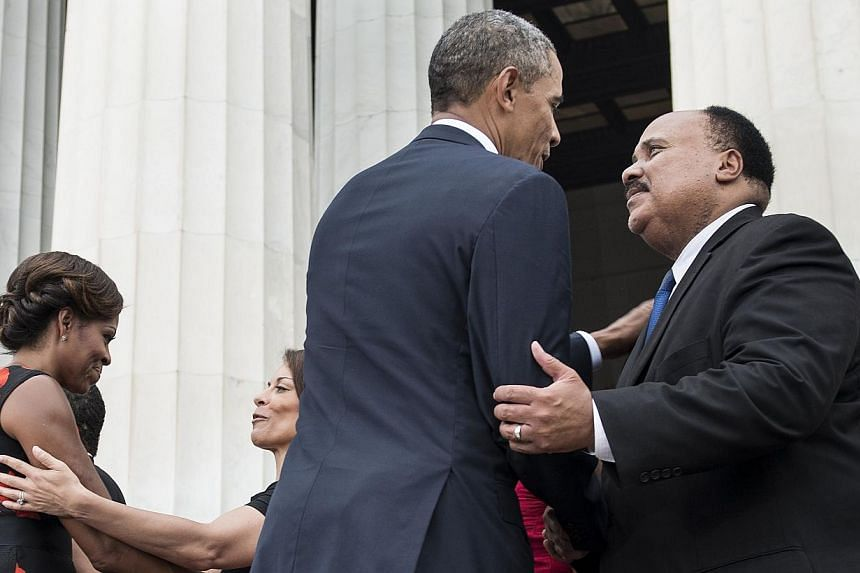 US President Barack Obama greets Martin Luther King III after speaking at the Lincoln Memorial on the National Mall on Aug 28, 2013 in Washington, DC. Obama and others spoke to commemorate the 50th anniversary of the US civil rights era March on Wash