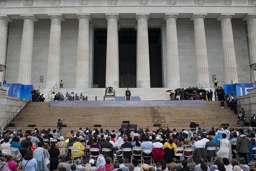 US President Barack Obama speaks during the Let Freedom Ring Commemoration and Call to Action marking the 50th anniversary of the March on Washington for Jobs and Freedom at the Lincoln Memorial in Washington, DC on Aug 28, 2013. Thousands gathered o