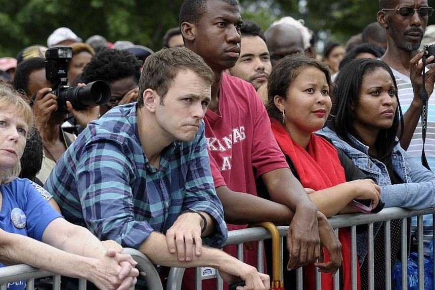 People listen as President Barack Obama speaks at the Lincoln Memorial in Washington, on Wednesday, Aug 28, 2103, during the 50th anniversary of the March on Washington. President Barack Obama led civil rights pioneers Wednesday in a ceremony for the