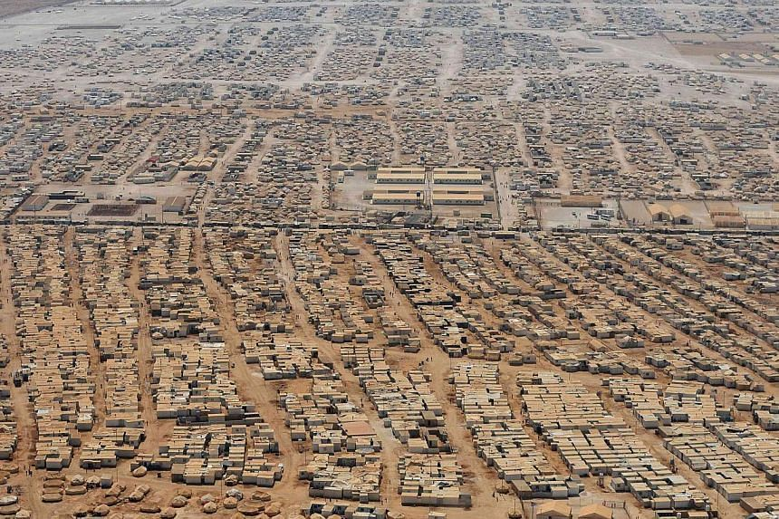 An aerial view shows the Zaatari refugee camp, near the Jordanian city of Mafraq on July 18, 2013. Britain's government on Thursday, Aug 29, 2013, published internal legal advice it had been given which it said showed it was legally entitled t
